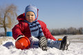 Little boy plays snow in winter Royalty Free Stock Image