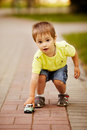 Little boy plays with toy car Royalty Free Stock Photo