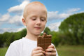 Little boy with pleasure eats chocolate Royalty Free Stock Photo