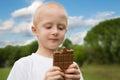 Little boy with pleasure eats chocolate Royalty Free Stock Photo