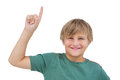 Little boy pointing upwards on white background Royalty Free Stock Photos