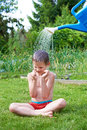 Little boy pouring water from watering can Royalty Free Stock Photo