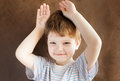 Little boy put his hands to his head as bunny ears Stock Photo