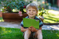 Little boy reading letter from friend in summer Royalty Free Stock Photo