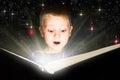 Little boy reading magic book Royalty Free Stock Photo