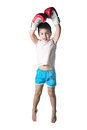 Little boy with red boxing gloves victory jump on white background isolated Royalty Free Stock Photo