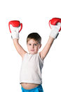 Little boy with red boxing gloves victory posing on white background isolated Royalty Free Stock Photo