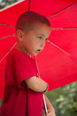Little boy in red with red umbrella young t shirt holds a umberlla Stock Photo