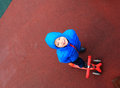 Little boy riding scooter, high angle view Royalty Free Stock Photo