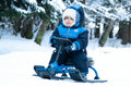 Little boy riding snowmobile Royalty Free Stock Photography