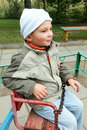 Little boy on rolling swing looking sideways Royalty Free Stock Photo