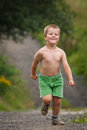 Little boy running with great joy Stock Image