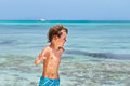 Little boy running on a tropical beach Royalty Free Stock Photo