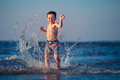 Little boy running through the water at beach Royalty Free Stock Photography