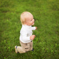 Little boy runs on a green grass Royalty Free Stock Images