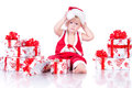 Little boy Santa Claus with Christmas gifts Stock Photos