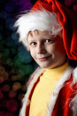Little boy in Santa Claus suit Stock Image