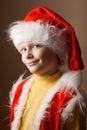 Little boy in Santa Claus suit Stock Images