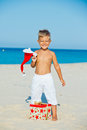 Little boy in santa hat cute with gift on tropical vacation Stock Photo