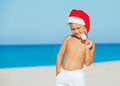 Little boy in santa hat cute on tropical vacation Stock Photo