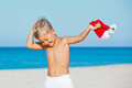 Little boy in santa hat cute with on tropical vacation Stock Photos