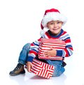 Little boy in santa s hat with gift box closeup smiling isolated on white Royalty Free Stock Images