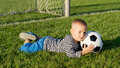Little boy saves a goal Stock Image