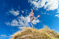 Little boy screaming on a pile of hay against the blue sky on a sunny day ittle field Royalty Free Stock Image