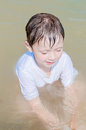 Little boy in the sea water Royalty Free Stock Image