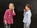 Little boy shouting in drawn mouthpiece and girl covering ears with her hands Royalty Free Stock Photo