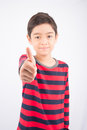 Little boy showing his thump up on white background Royalty Free Stock Images