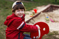 Little boy sit and teeth smile at playground Stock Photography