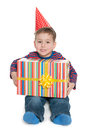 Little boy sits with a gift box holds and against the white background Stock Image
