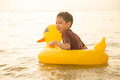 Little boy sitting  on the beach face look happy Royalty Free Stock Photo