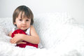 Little boy sitting in a big chair on white background holding red heart Royalty Free Stock Photos