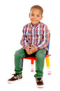 Little boy sitting in chair isolated in white Royalty Free Stock Image
