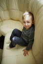 Little boy sitting on couch Royalty Free Stock Photo