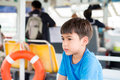 Little boy sitting in ferry cross over the river witing Stock Photo