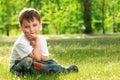 Little boy sitting on grass Royalty Free Stock Photo