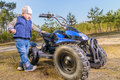 Little boy sitting on quad bike in the forest Stock Image