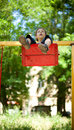 Little boy sitting on a swing Royalty Free Stock Photography