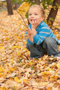 Little Boy Sitting On Yellow A...