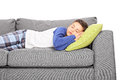 Little boy sleeping on couch isolated white background Royalty Free Stock Photos
