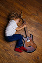 Little Boy Sleeping And Hugging Guitar Royalty Free Stock Photo