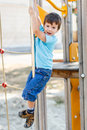 Little boy slide down on pole bad outdoors Royalty Free Stock Photos