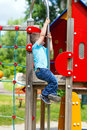 Little boy slip down on the pole at playground young active Royalty Free Stock Images
