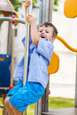 Little boy slip on pole at jungle gym dangerous Royalty Free Stock Photo
