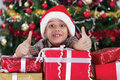 Little boy smiling with gift box near the christmas tree happy Stock Images