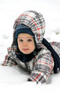 Little boy in snow fallen the Stock Photo