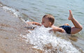 Little boy splashing in the sea Stock Image
